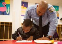 Police Officer Frank Holmes and student, photo by Brianna Spause